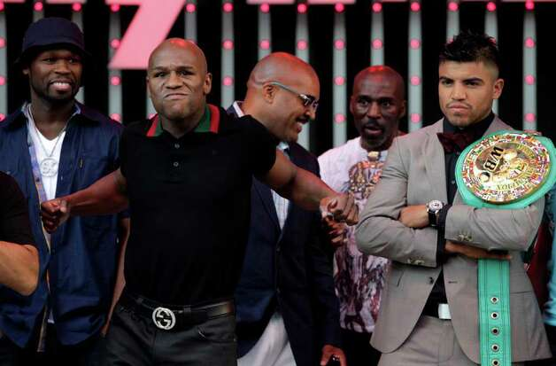 Boxers Floyd Mayweather Jr., left, and Victor Ortiz, right, pose for photos at CityWalk in Universal City, Monday, Sept. 12, 2011. The two will fight in a WBC welterweight title match Saturday in Las Vegas. Photo: AP