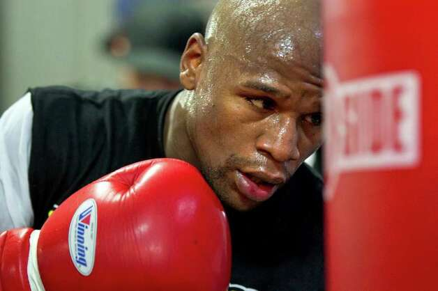 Floyd Mayweather works out on the heavy bag at his gym, Tuesday, Sept. 6, 2011, in Las Vegas. Mayweather will fight Victor Ortiz on Sept. 17 for the WBC World Welterweight championship. Photo: AP