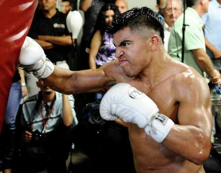In this photo taken on Sept. 17, 2011, provided by Hoganphotos.com, boxer Victor Ortiz works out works out in Ventura, Calif., in preparation for defending his WBC welterweight title against Floyd Mayweather on Sept. 17, 2011 in Las Vegas. Photo: AP