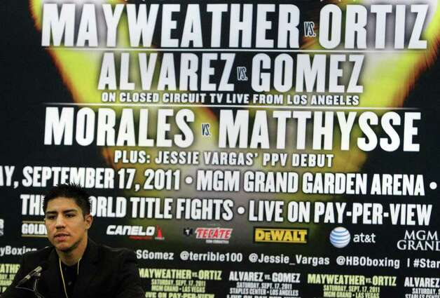 Boxer Jesse Vargas promotes the upcoming Floyd Mayweather versus Victor Ortiz fight during a press conference at the Alamodome on Thursday, Aug. 4, 2011. Vargas will be fighting in his pay-per-view debut against Josesito Lopez on September 17 in Las Vegas. Kin Man Hui/kmhui@express-news.net Photo: KIN MAN HUI, SAN ANTONIO EXPRESS-NEWS / SAN ANTONIO EXPRESS-NEWS