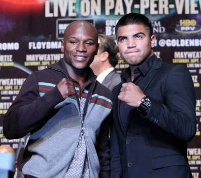 Floyd Mayweather, left, and Victor Ortiz pose during a news conference ahead of their Sept. 17 bout for Ortiz's WBC welterweight title,  Tuesday, June 28, 2011 in New York. Photo: AP