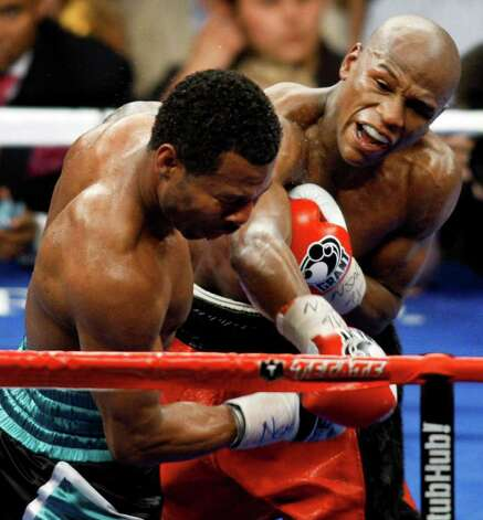 Floyd Mayweather Jr., right, connects with a punch against Shane Mosley, during their WBA welterweight boxing match Saturday, May 1, 2010, in Las Vegas. Mayweather Jr. beat Shane Mosley in a unanimous decision. Photo: AP