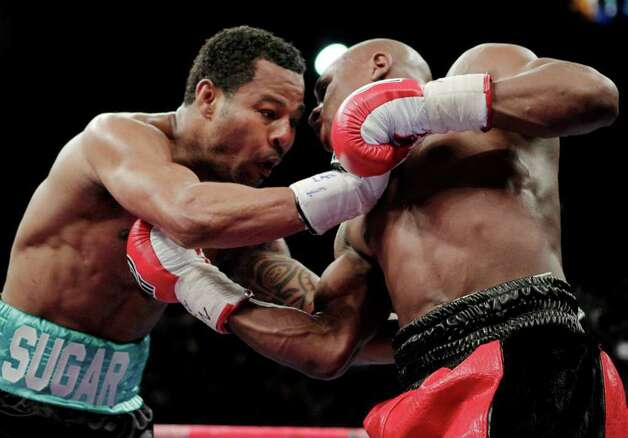 Shane Mosley, left, and Floyd Mayweather Jr. exchange blows during their WBA welterweight boxing match Saturday, May 1, 2010, in Las Vegas. Photo: AP