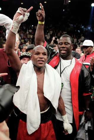 Floyd Mayweather Jr. celebrates his victory over Shane Mosley after their WBA welterweight boxing match Saturday, May 1, 2010, in Las Vegas. Mayweather Jr. beat Shane Mosley in a unanimous decision. Photo: AP