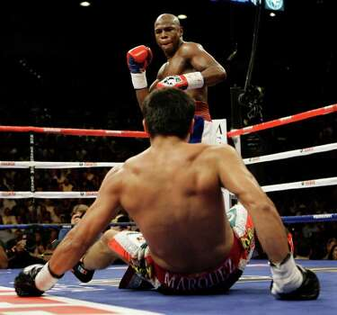 Floyd Mayweather Jr. steps back after knocking down Juan Manuel Marquez, of Mexico, during their welterweight boxing match in Las Vegas, Saturday, Sept. 19, 2009. Photo: Laura Rauch, AP / FR158760 AP