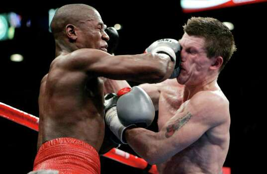 Floyd Mayweather Jr., left, punches Ricky Hatton, of Great Britain, during their WBC welterweight boxing title fight at the MGM Grand hotel-casino in Las Vegas, Saturday, Dec. 8, 2007. Mayweather won by 10th round knockout. Photo: Jae C. Hong, AP / AP