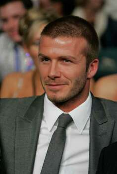 Soccer player David Beckham sits in his seat before the Floyd Mayweather Jr. versus Ricky Hatton, of Great Britain, WBC welterweight boxing title fight at the MGM Grand hotel-casino in Las Vegas, Saturday, Dec. 8, 2007. Photo: Jae C. Hong, AP / AP