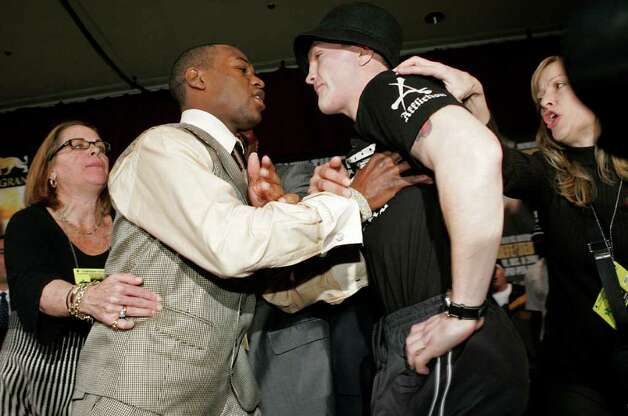 WBC welterweight champion Floyd Mayweather Jr., left, pushes Ricky Hatton, of Britain, as they face off after a news conference at the MGM Grand hotel and casino in Las Vegas, Wednesday, Dec. 5, 2007. The two will fight in a WBC welterweight title match, Saturday, Dec. 8, in Las Vegas. Photo: Jae C. Hong, AP / AP
