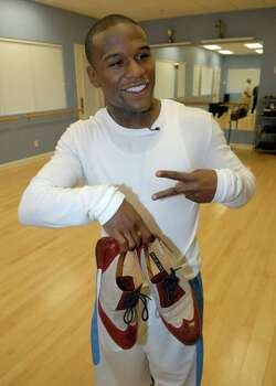 "** ADVANCE FOR WEEKEND OF OCT 13-15 ** In this photo provided by Golden Boy Promotion, boxer Floyd Mayweather Jr. poses with a pair of shoes during practice for a television reality show  ""Dancing With The Stars"" at a dance studio in Las Vegas, Saturday, Oct. 6, 2007. For four hours a day, four days a week, Mayweather Jr. is preparing not to be his sport's pound-for-pound champion, but the best amateur celebrity dancer on the show. Mayweather Jr. is scheduled to fight Ricky Hatton, of England, on Dec. 8. Photo: Rob Delorenzo, AP / Golden Boy Promotions"