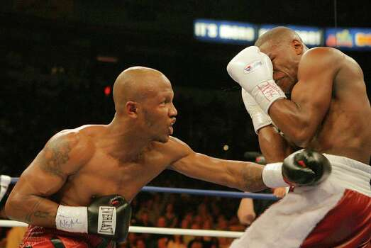 Zab Judah, left, lands a punch to the body of  Floyd Mayweather Jr. , right, in the second round of their IBF welterweight title boxing match at Thomas and Mack Center in Las Vegas, Saturday, April 8, 2006. Photo: JAE C. HONG, AP / AP