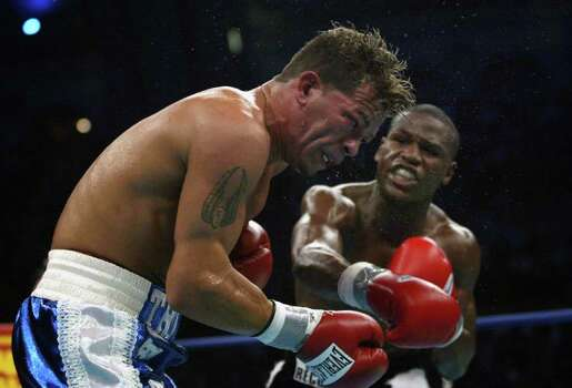 Floyd Mayweather Jr., right, of Las Vegas, Nev., hits Arturo Gatti of Jersey City, N. J.   in second round action of their WBO World Super Lightweight Championship bout at Atlantic City's Boardwalk Hall Saturday, June 25, 2005 in Atlantic City, N.J.. Photo: MEL EVANS, AP / AP