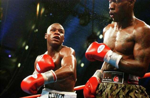 Floyd Mayweather, left, recovers after throwing a punch at DeMarcus Corley during the third round  of the Super lightweight eliminator fight at Boardwalk Hall in  Atlantic City, N.J., Saturday, May, 22, 2004.  The fight is scheduled for 12 rounds. Photo: BRIAN BRANCH PRICE, AP / AP