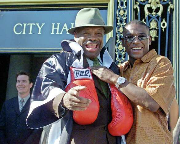 "San Francisco Mayor Willie Brown, left, wearing a robe and boxing gloves, stands outside City Hall with WBC super featherweight champion ""Pretty Boy"" Floyd Mayweather Jr., right, in San Francisco, Thursday, Nov. 8, 2001.  The mayor was promoting Mayweather's title fight against Jesus ""El Matador"" Chavez which is scheduled to take place in San Francisco, Saturday night.  The bout will be the first major fight to be held in San Francisco in 40 years. Photo: ERIC RISBERG, AP / AP"