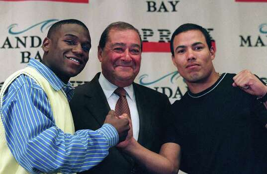 Floyd Mayweather Jr., left, promoter Bob Arum and Jose Luis Castillo, right, pose Wednesday, Aug. 7, 2002, in Las Vegas during a news conference to promote their Oct. 5 fight. Photo: CHRISTINE H. WETZEL, AP / LAS VEGAS REVIEW-JOURNAL