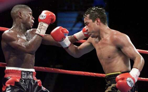 WBC super featherweight champion Floyd Mayweather Jr., left,  and Goyo Vargas battle it out in the eighth round during their title fight at the MGM Grand Garden in Las Vegas on Saturday, March 18, 2000. Mayweather retained his title by unaminous decision. Photo: LORI CAIN, AP / AP