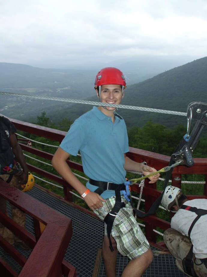 Writer M.B. Tuccio checks his gear before heading out on a zip line at Hunter Mountain. Photo: Contributed Photo