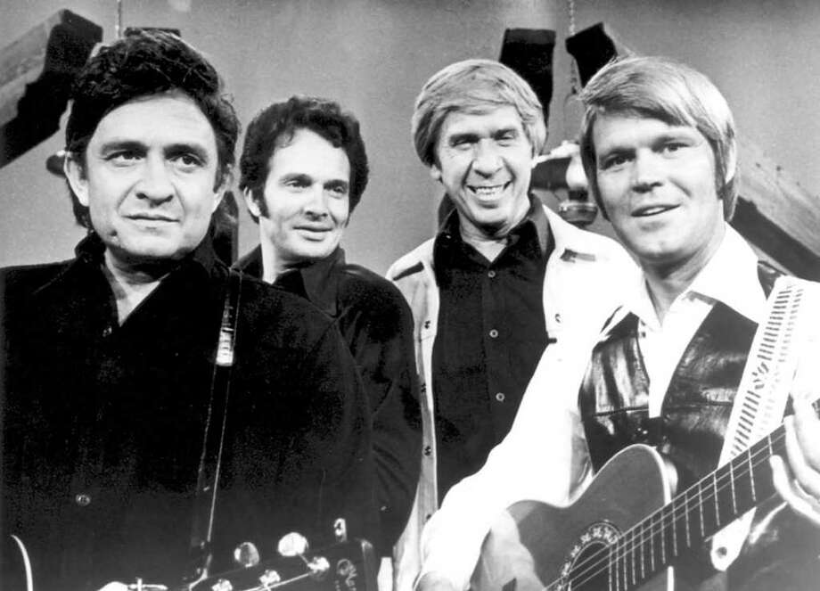 One among legends: Glen Campbell, right, appears with, from left, country singers Johnny Cash, Merle Haggard and Buck Owens 30 years ago on The Glen Campbell Goodtime Hour. / COUNTRY MUSIC TELEVISION