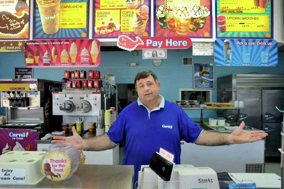 Albert Yaldeh talks about the impact recent flooding has had on his New Milford business, Carvel Ice Cream Stores Friday, Sept. 16, 2011. Photo: Michael Duffy / The News-Times