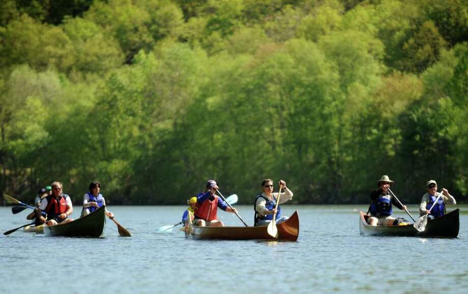 Canoes along the Housatonic River in Shelton, Conn. on Thursday, May 12, 2011 Photo: Autumn Driscoll, ST / Connecticut Post