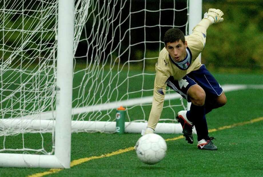 Wolcott Tech's Mike Chiaravalloti dives for the ball during a penalty kick that bounced off the goal post during their game against Abbott Tech at Broadview Middle School in Danbury on Thursday, Sept. 15, 2011. Abbott Tech won 4-0. Photo: Jason Rearick / The News-Times