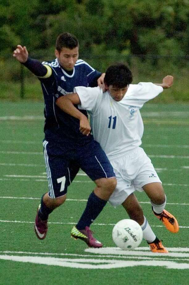 Wolcott Tech's Frank Chiaravolloti, left, battles Abbott Tech's Brayan Suarez for control of the ball during their game at Broadview Middle School in Danbury on Thursday, Sept. 15, 2011. Abbott Tech won 4-0. Photo: Jason Rearick / The News-Times