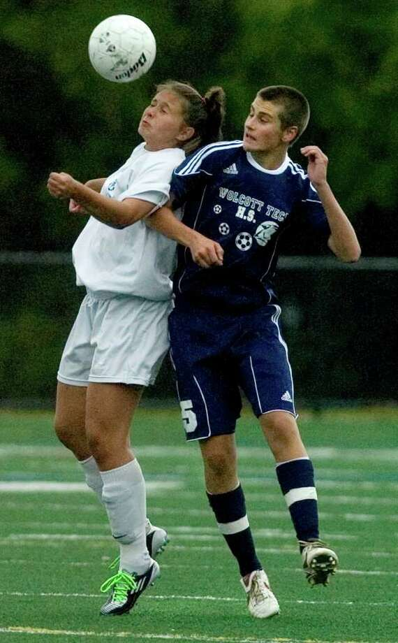 Abbott Tech's Alisan Sartori, left, heads the ball away from Wolcott Tech's Brandon Mann during their game at Broadview Middle School in Danbury on Thursday, Sept. 15, 2011. Abbott Tech won 4-0. Photo: Jason Rearick / The News-Times