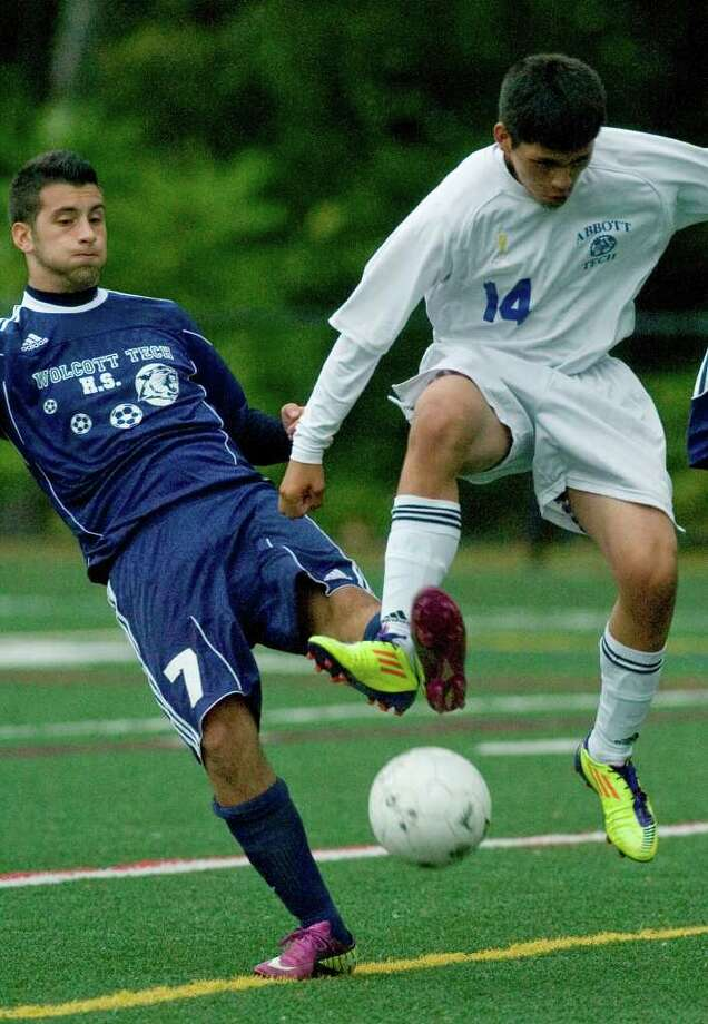 Wolcott Tech's Frank Chiaravolloti, left, tangles feet with Abbott Tech's Carlos Sanchez during their game at Broadview Middle School in Danbury on Thursday, Sept. 15, 2011. Abbott Tech won 4-0. Photo: Jason Rearick / The News-Times