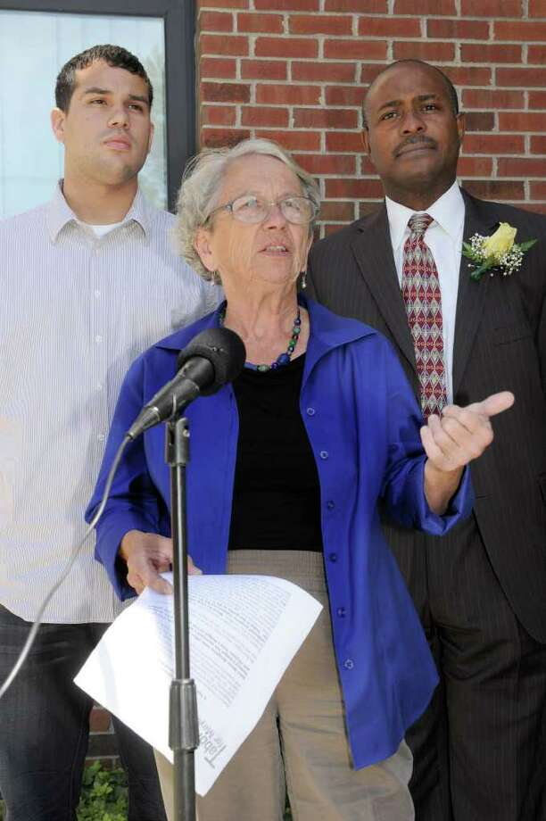 Lynn Taborsak, center, Democrat mayoral candidate, speaks to the press Friday outside Danbury City Hall. She is flanked by left, Luis Rodriguez and right is Greg Williams, Democrat candidates for City Council at-large seats. Photo taken Friday, Sept. 16, 2011. Photo: Carol Kaliff