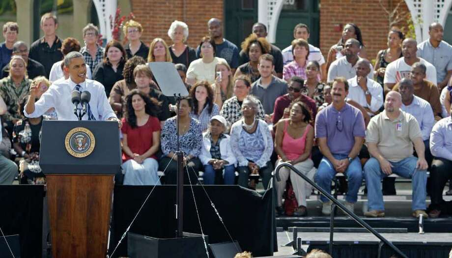 President Barack Obama talks about the American Jobs Act at Fort Hayes Arts and Academic High School, Tuesday, Sept. 13, 2011, in Columbus, Ohio. (AP Photo/Tony Dejak) Photo: Tony Dejak / AP