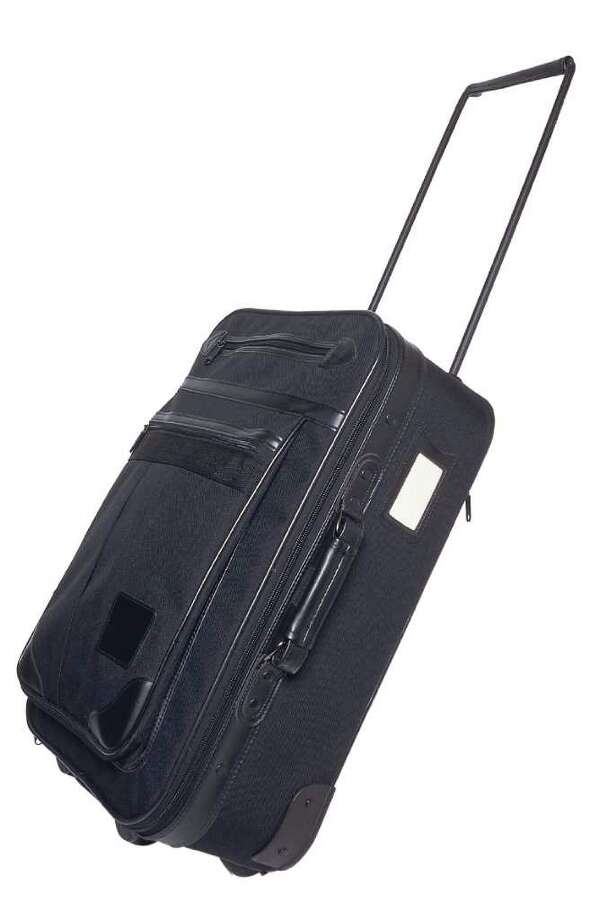 black luggage with wheels; travel / handout / stock agency