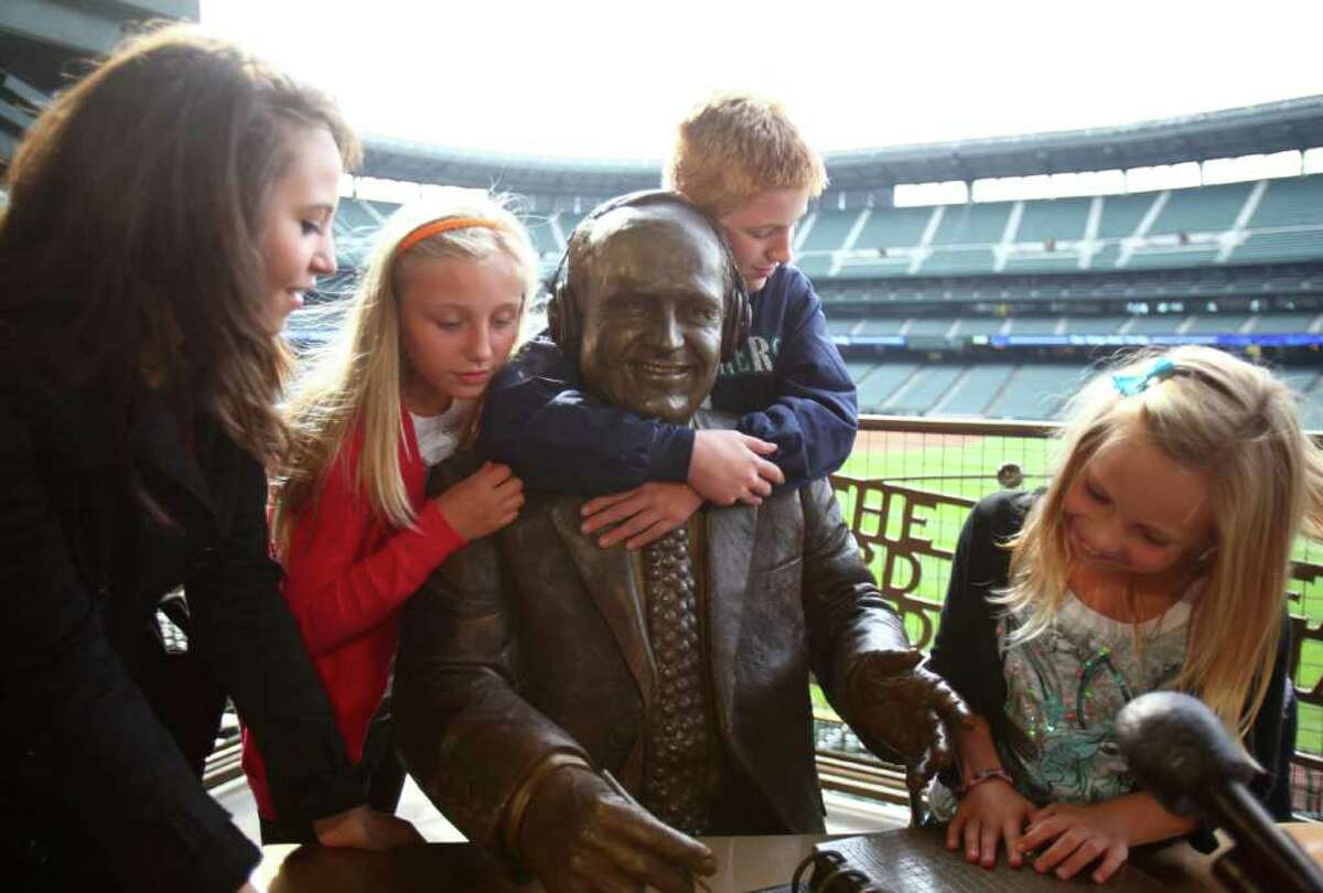 From left, Destiny Niehaus, 17, Maddie Dunn, 10, Steven Dunn, 12 and Lexi Niehaus, 8, gather around a statue of their grandfather, Dave Niehaus, during the unveiling of a statue memorializing the voice of the Mariners. Niehaus, who died in 2010, was the broadcast voice of the team for decades. Photographed on Friday, September 16, 2011 at Safeco Field in Seattle.