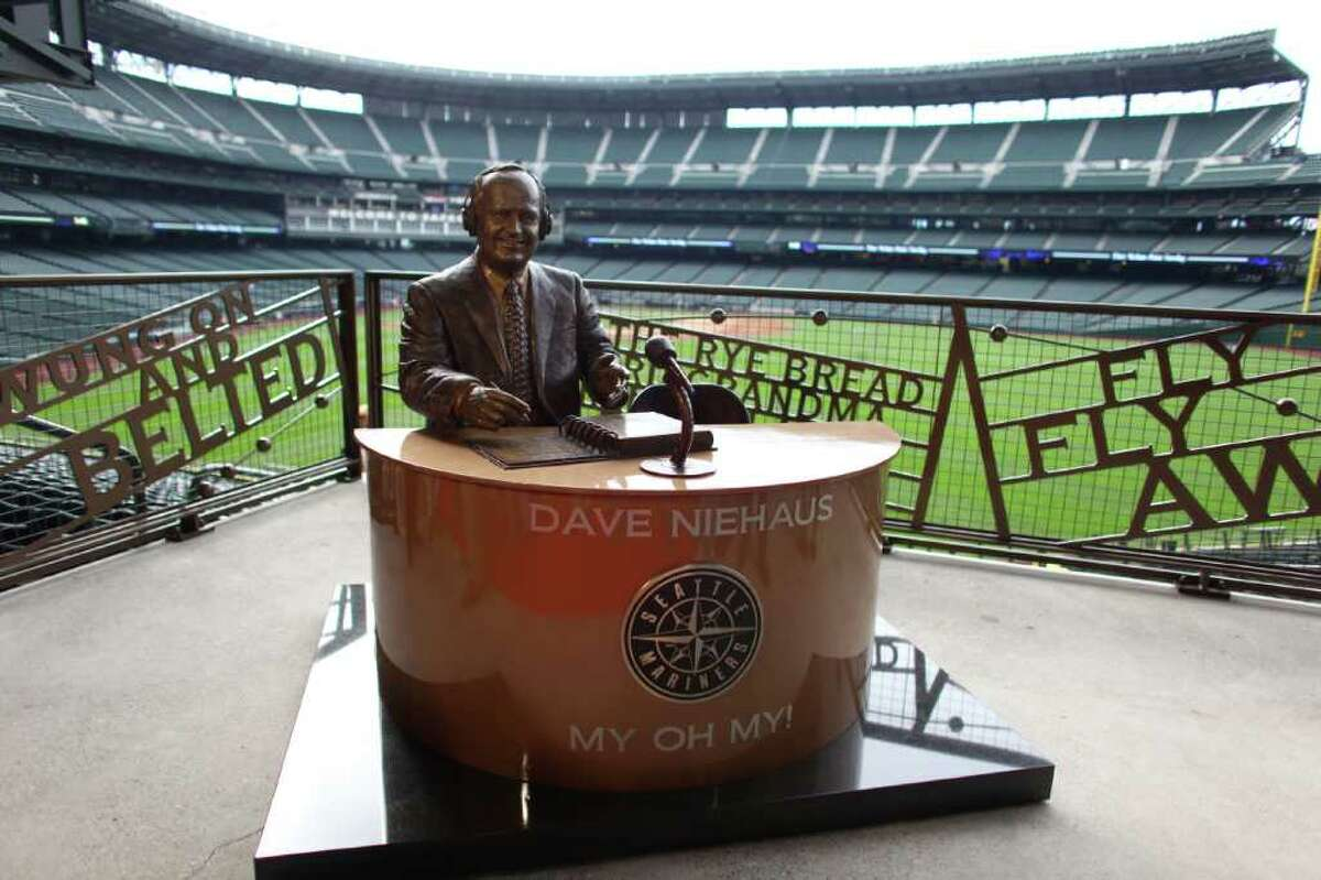 A statue memorializing the voice of the Mariners, Dave Niehaus, is shown after the unveiling of the statue. Niehaus, who died in 2010, was the broadcast voice of the team for decades.