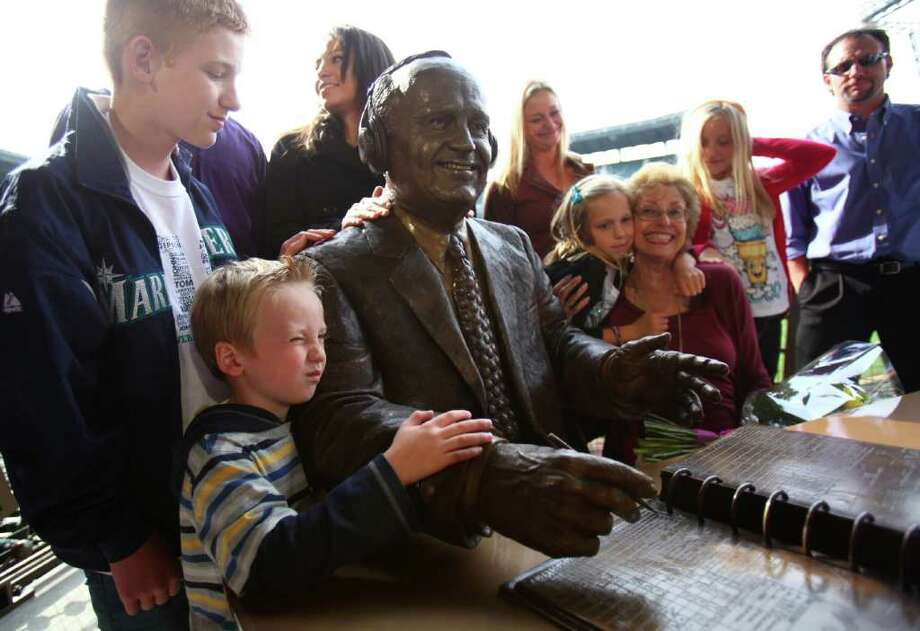 Family members gather around a statue memorializing the voice of the Mariners, Dave Niehaus. Photo: JOSHUA TRUJILLO / SEATTLEPI.COM