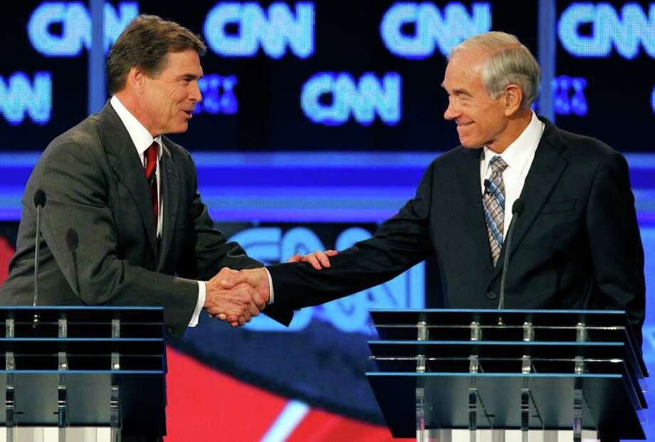 MIKE CARLSON : ASSOCIATED PRESS  TEXAN VS. TEXAN: Texas Gov. Rick Perry, left, shakes hands with Rep. Ron Paul, R-Texas, after the recent Republican presidential in Tampa, Fla. Paul, who trails his fellow Texan in most polls, says he will not be a third-party candidate. Photo: Mike Carlson / FR155492 AP