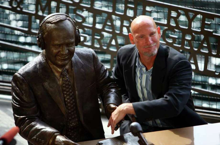 Former Mariner Jay Buhner shakes the bronze hand of a statue memorializing the voice of the Mariners, Dave Niehaus. Photo: JOSHUA TRUJILLO / SEATTLEPI.COM