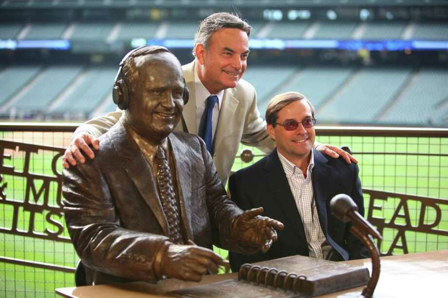 Broadcaster Rick Rizzs and producer Kevin Cremin pose with a statue memorializing the former voice of the Mariners, Dave Niehaus. Photo: JOSHUA TRUJILLO / SEATTLEPI.COM