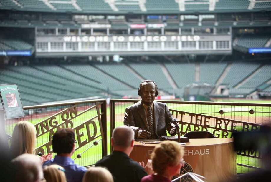 A statue memorializing the voice of the Mariners, Dave Niehaus is unveiled at Safeco Field. Photo: JOSHUA TRUJILLO / SEATTLEPI.COM