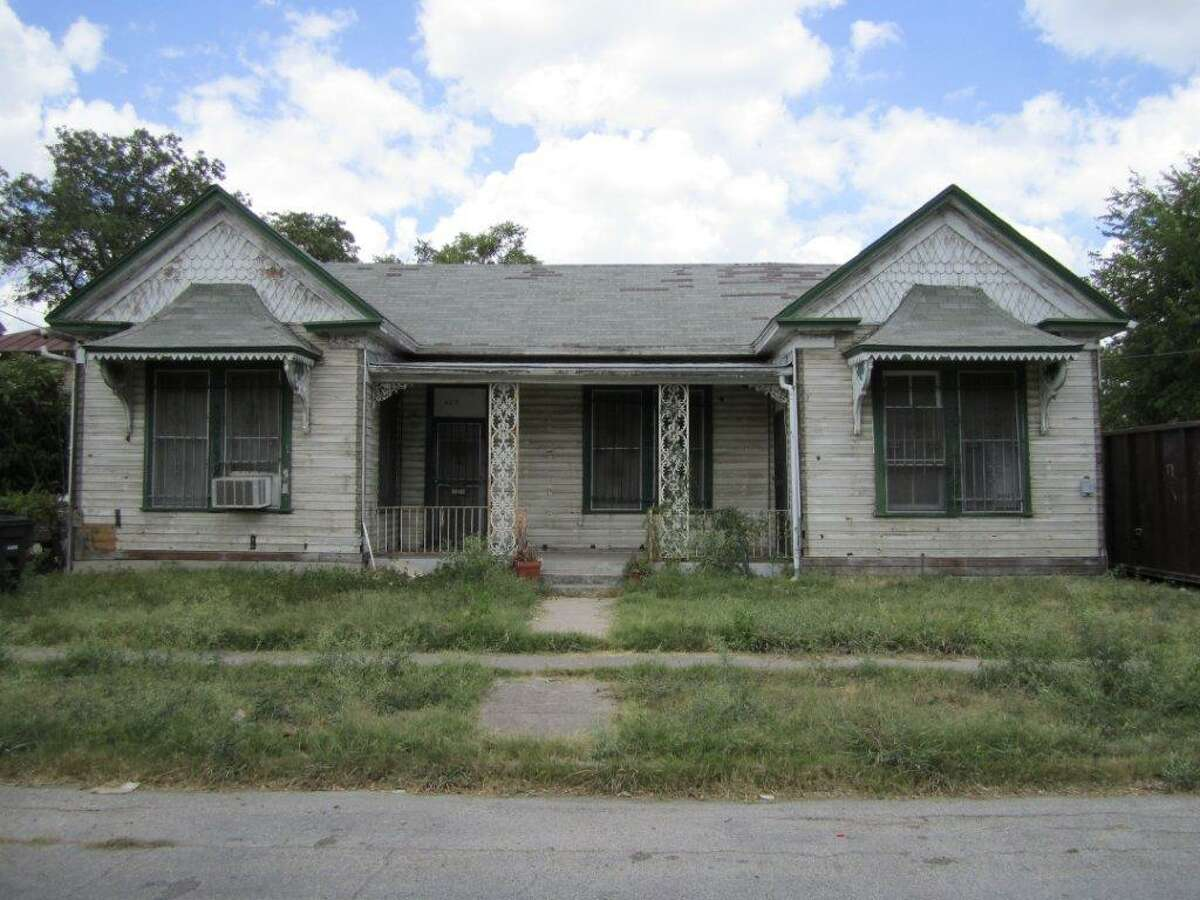 This is a before shot of the duplex at top before it was rehabilitated by Juarez.
