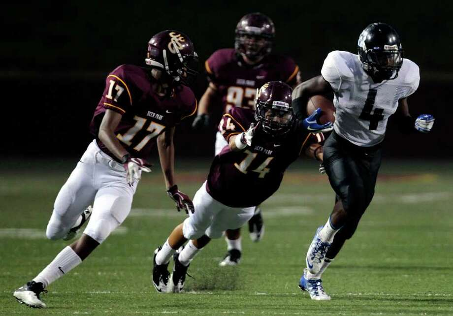 Westside High School running back B.J. Catalon runs the ball for a 78-yard touchdown in the first quarter of a football game against Deer Park High School at Abshier Stadium  Friday, Sept. 16, 2011, in Deer Park. Photo: Cody Duty, Houston Chronicle / © 2011 Houston Chronicle