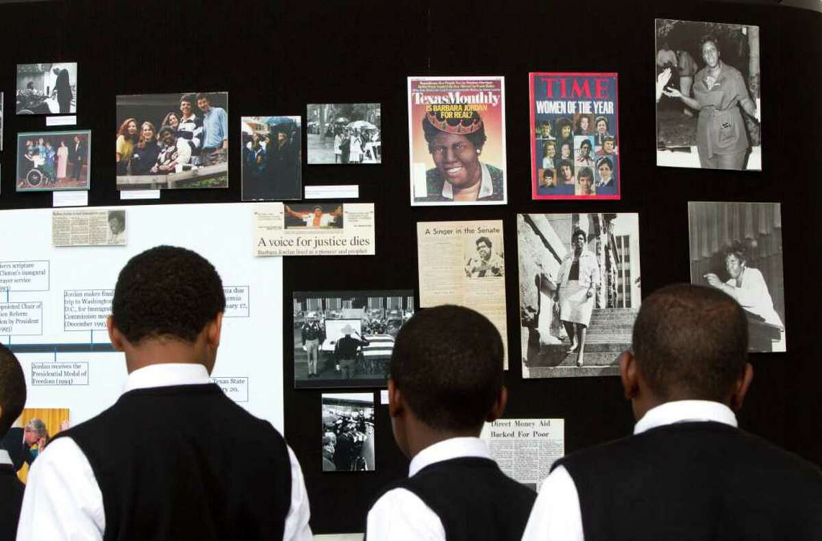 Students from Wallipp Preparatory Academy examine photos of Jordan during the ceremony.