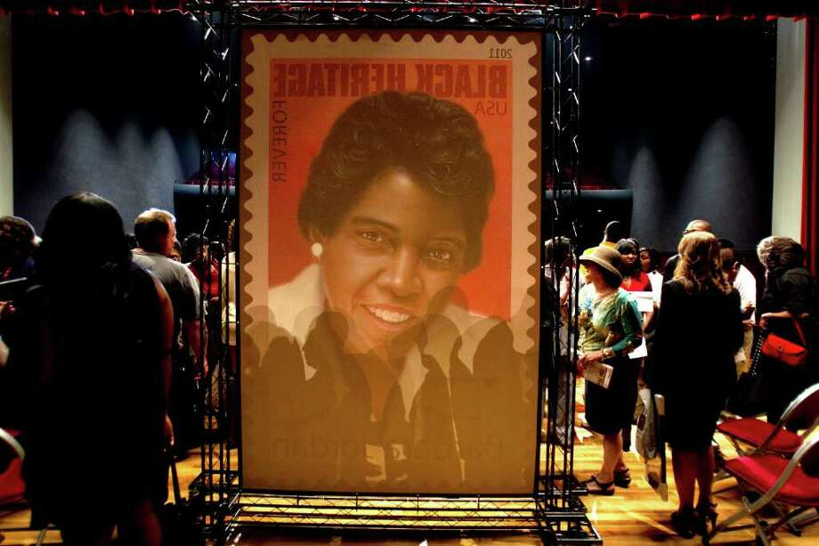 A large poster featuring a stamp of Barbara Jordan is on display during First-Day-of-Issue Ceremony for the Barbara Jordan commemorative stamp at Texas Southern University in Houston. The Jordan stamp is the 34th in the Black Heritage Collection by the United States Postal Service. Photo: Brett Coomer, Houston Chronicle / © 2011 Houston Chronicle