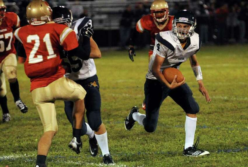 Highlights from boys football action between Stratford and Weston in Stratford, Conn. on Friday September 16, 2011. Weston's #4 Tyler Hassett moves the ball.