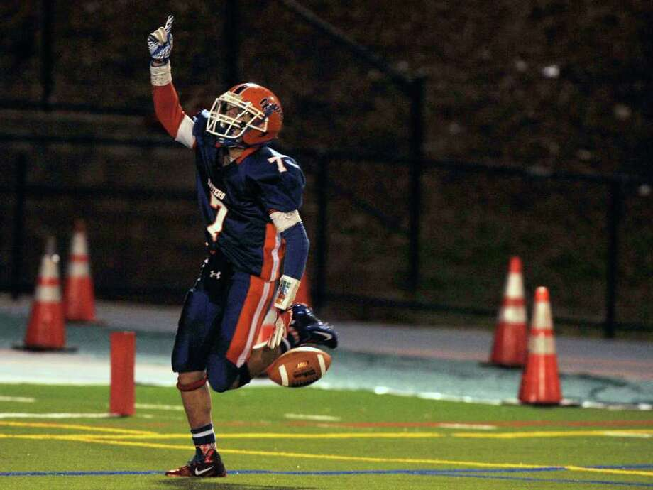 Danbury's Corey Chaffee celebrates after a touchdown reception against Norwalk at Danbury High School on Friday, Sept. 16, 2011. Photo: Jason Rearick / The News-Times