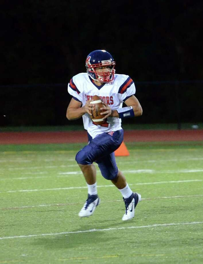 Brien McMahon's Damien Vega (11) prepares to throw a pass during the football game against Fairfield Warde at Fairfield Warde High School on Friday, Sept. 16, 2011. Photo: Amy Mortensen / Connecticut Post Freelance