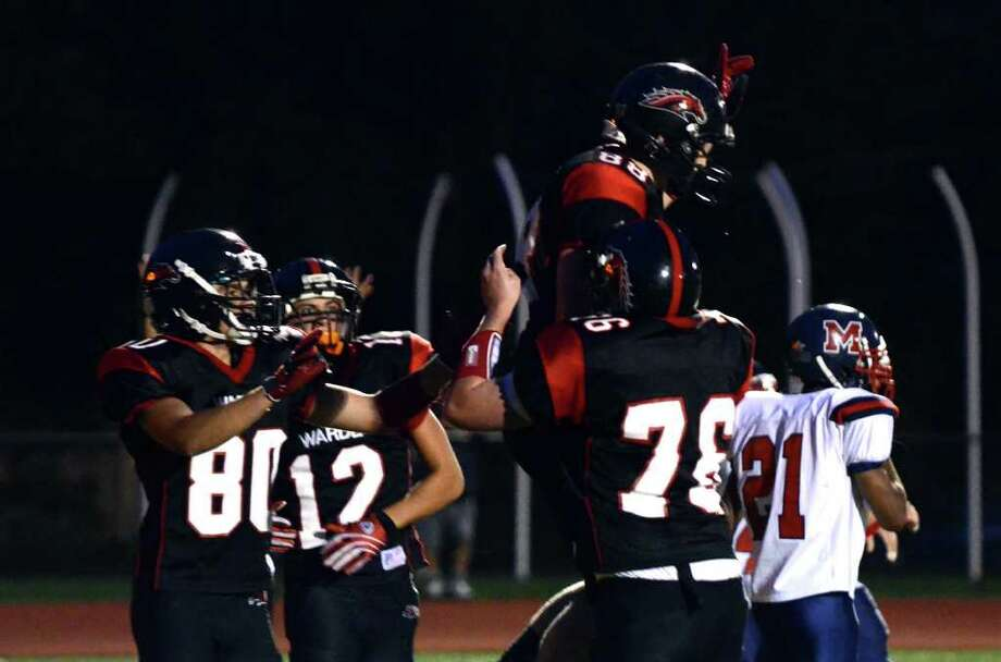 Fairfield Warde's Kevin Sullivan (88) celebrates a touch down with teammates during the football game against Brien McMahon at Fairfield Warde High School on Friday, Sept. 16, 2011. Photo: Amy Mortensen / Connecticut Post Freelance