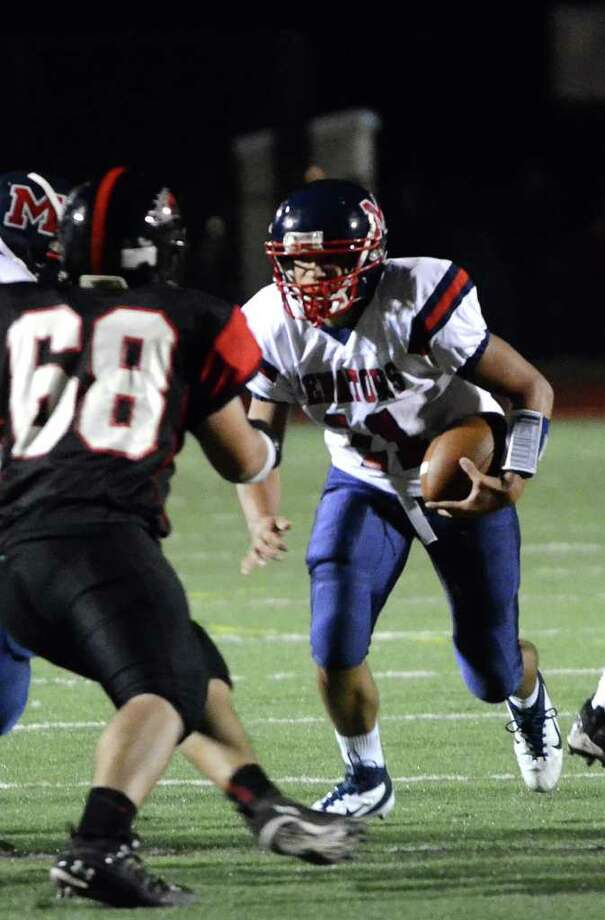 Brien McMahon's Damien Vega (11) stares down his opponent Fairfield Warde's Jordan Irizarry (68) during the football game at Fairfield Warde High School on Friday, Sept. 16, 2011. Photo: Amy Mortensen / Connecticut Post Freelance