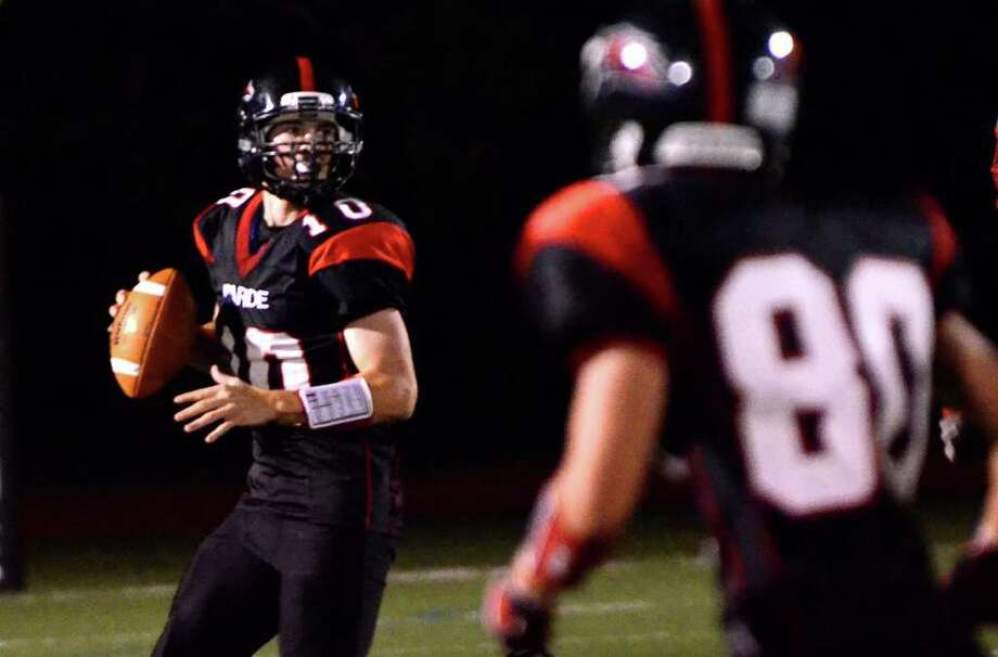 Fairfield Warde's Chris Foley (10) prepares to throw a pass to Michael Astolfi (80) during the football game against Brien McMahon at Fairfield Warde High School on Friday, Sept. 16, 2011. Photo: Amy Mortensen / Connecticut Post Freelance