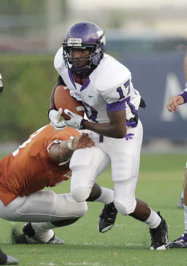 Humble's Jer'Kalyn Holiday #17 rushes up the middle against Dobie during a high school football game Friday, September 16, 2011 in Pasadena, Texas. Photo: Bob Levey, Houston Chronicle / ©2011 Bob Levey