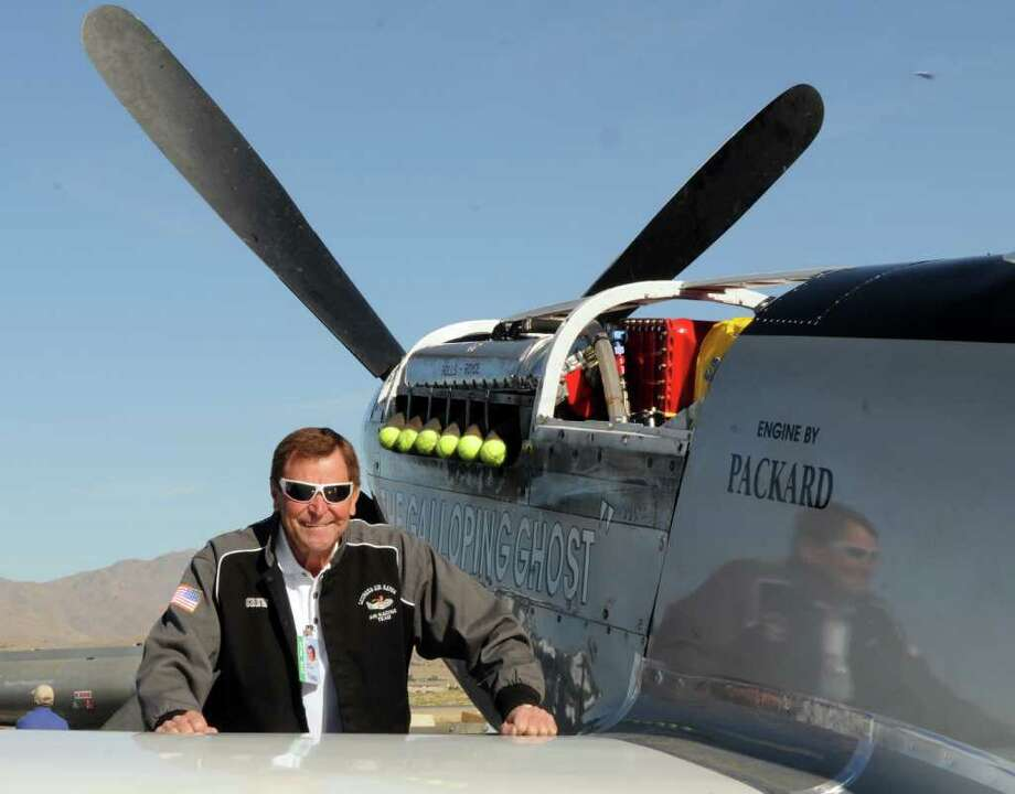This Wednesday, Sept. 15, 2010 photo, shows long time Reno Air Race pilot Jimmy Leeward with his P51 Mustang.  A spokesman for Reno's National Championship Air Races says the P-51 Mustang that crashed into a box seat area at the front of the grandstand Friday, Sept. 16, 2011, at the air race was piloted by Leeward.  (AP Photo/The Reno Gazette-Journal, Marilyn Newton) Photo: Marilyn Newton / The Reno Gazette-Journal