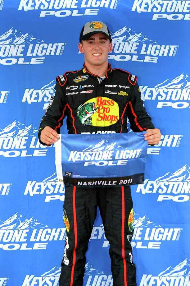 LEBANON, TN - JULY 22: Austin Dillon, driver of the #3 Bass Pro Shops Chevrolet, poses after winning the pole position for the NASCAR Camping World Truck Series Lucas Deep Clean 200 at Nashville Superspeedway on July 22, 2011 in Lebanon, Tennessee. (Photo by Jason Smith/Getty Images for NASCAR) Photo: Jason Smith / 2011 Getty Images